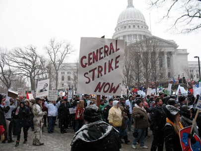 Madison, Wisconsin, February 2011: over 100,000 unionists surround the state capitol to block Right to Work. A general strike was discussed, but local AFL-CIO tops called off protests in favor of electoral support for Democrats. Result: Wisconsin is a right-to-slave state. Labor's got to play hardball to win! (Photo: Yuri Keegstra)