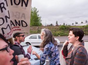 "A supporter of the ""pro-life"" conference (center) repeatedly urged motorists to run down CSWP picketers."